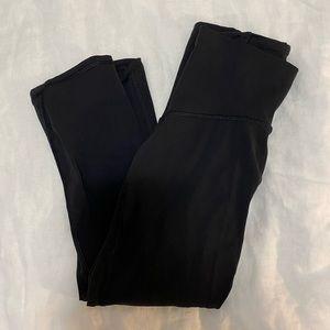 3/4 length black lululemon leggings w/ sheer panel